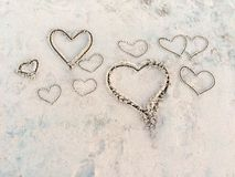 Hearts in the sand on the beach. royalty free stock photography