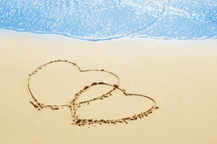 Hearts on the sand Stock Photography