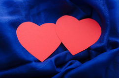 Hearts on satin Royalty Free Stock Photography