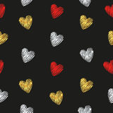 Hearts seamless pattern. Red, silver and golden striped hearts on dark. Royalty Free Stock Image