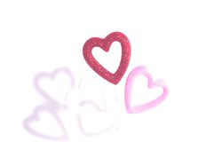 Hearts and Shadows. Puffy pink and red glitter Hearts and Shadows Royalty Free Stock Photos