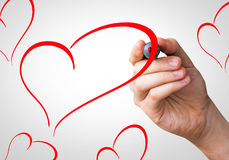 Hearts shape hand writing with a red mark on a transparent board Royalty Free Stock Images