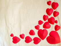 Hearts shape on old paper background Stock Photos
