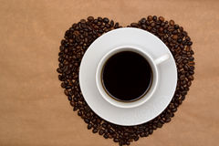 Hearts shaped coffee beans and a cup of coffee, Top view Stock Photo