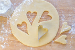 Hearts shaped cookie cutter. On raw cookie dough Royalty Free Stock Photos