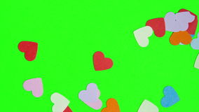 Hearts shaped on the green screen. You can replace the green screen on any of your image stock footage