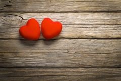 Valentine`s Day red velvet hearts on old wooden floor. Hearts Shaped , Valentine`s day background royalty free stock photography