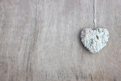Hearts shapes with wool texture over wooden textured background Royalty Free Stock Image