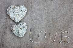 Hearts shapes with wool texture over wooden textured background Royalty Free Stock Photos