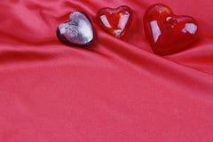 Hearts on silk Stock Photo