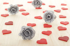 Hearts with silver colored roses for valentines day Royalty Free Stock Images