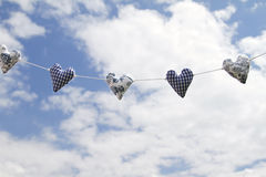 Hearts in the sky. Cotton hearts in the blue sky Stock Images