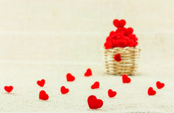 Hearts in small wooden weave basket putting on the sack fabric. Royalty Free Stock Photos