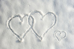Hearts in snow. Three hearts written in the snow Royalty Free Stock Photos