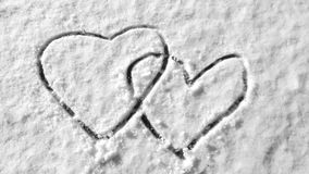 Hearts on snow hand drawing symbol romantic wintertime. Ice cold surface Royalty Free Stock Photography