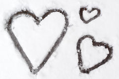 Hearts in snow. Hearts made in the snow for St.Valentine day Royalty Free Stock Photo