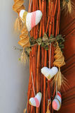 Hearts and spirally woven corn dolly Royalty Free Stock Photos