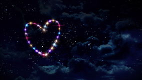 Hearts star with green background. Starry night in space background with heart forming from stars stock video footage