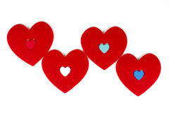 Hearts staying close to eachother. In white background Stock Images
