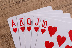 Hearts suit playing cards on wooden Stock Photo