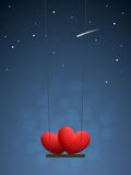 Hearts on swing Stock Photo