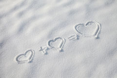 Hearts symbols in the snow Royalty Free Stock Images
