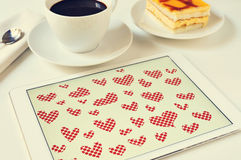 Hearts in a tablet Royalty Free Stock Images