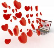 Hearts take off from the screen of laptop Stock Image