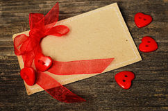 Hearts tied with red ribbon Royalty Free Stock Photos
