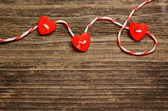 Hearts tied with red ribbon Stock Image