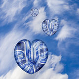 Hearts to the Wind. Three hearts in the sky against white clouds.  Could portray travel, family, love or things of a spiritual nature Stock Photography