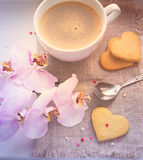 Hearts, valentine, cookies, orchid and a cup of coffee. Tinted. Stock Image