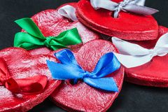 Hearts Valentines clay with colored bows. Decorations for Valentine`s day or wedding Stock Photos