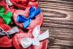 Hearts Valentines clay with colored bows. Decorations for Valentine`s day or wedding Royalty Free Stock Photography