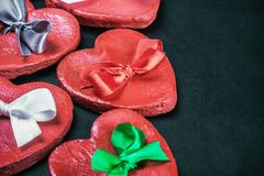 Hearts Valentines clay with colored bows. Decorations for Valentine`s day or wedding Stock Photography