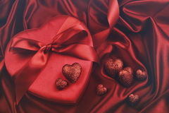 Hearts for valentines Day on satin Royalty Free Stock Images