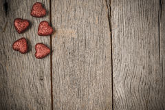 Hearts on Vintage Wood Background Royalty Free Stock Photos