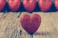 Hearts on Vintage Wood Background Stock Images