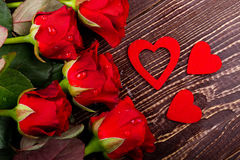 Hearts and water dropped roses. Royalty Free Stock Photography
