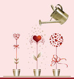 Hearts and watering can. Stock Photography