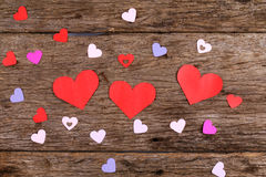 Hearts on weathered wood surface Stock Image