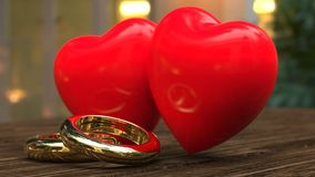Hearts and wedding rings concept Stock Images