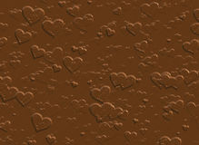 Hearts from wet milk chocolate. sweet background. S Royalty Free Stock Photo