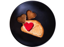 The hearts which are cut out from fried white and rye bread on a Stock Photography