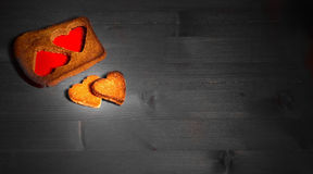 The hearts which are cut out from rye fried bread on gray boards Royalty Free Stock Photos
