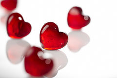 Hearts on white. Glass hearts on white background Stock Image