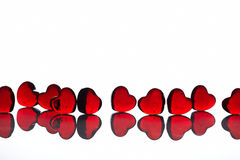 Hearts on white. Glass hearts on white background Royalty Free Stock Photography