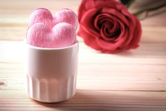 2 hearts in white glass on the wooden floor. Valentine`s Day Concept stock photos