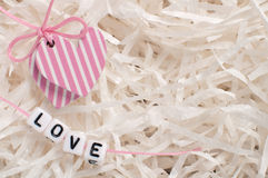 Hearts on white paper with letters love Royalty Free Stock Photo