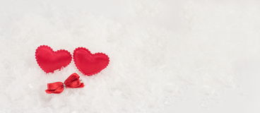 Hearts on a white snowy background Royalty Free Stock Photo